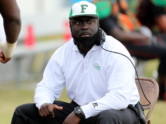 Coach Quinn Gray watches a video replay as FAMU falls to the Delaware State Hornets 29-21 during the final home football game of the season at Bragg Memorial Stadium on Saturday Nov., 16, 2013.