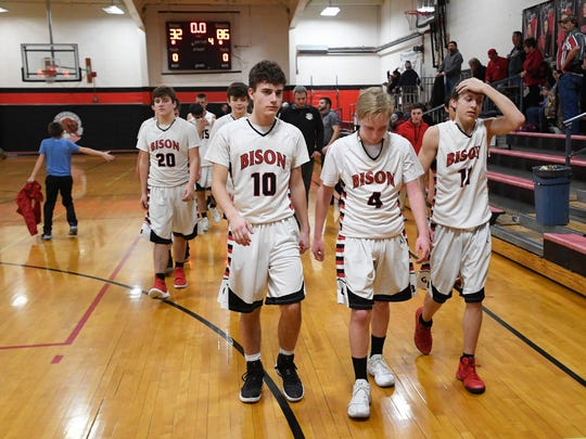 The Grayville Bison head to the locker room after losing to the Woodlawn Cardinals 86-32 in Grayville Tuesday, January 23, 2018.