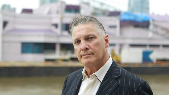 Waterfront owner Jeff Ruby with the restaurant in the background on May 19, 2011 in Covington.