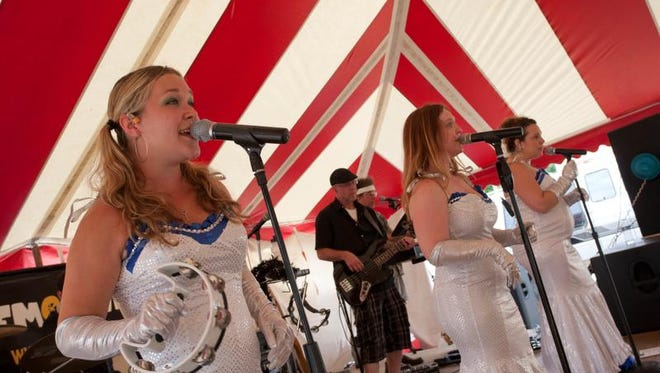 Shelby Jones (left) performs with LemonWheel during the 2012 edition of the Pennsy Trail Art Fair & Music Festival in Greenfield.