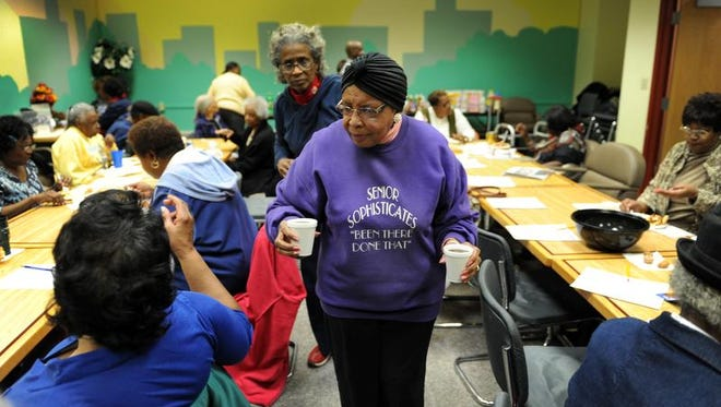 Retired nurse Lula Mae Nichols volunteers during a noon lunch in November 2013 at the Martin Luther King Community Center, Indianapolis.