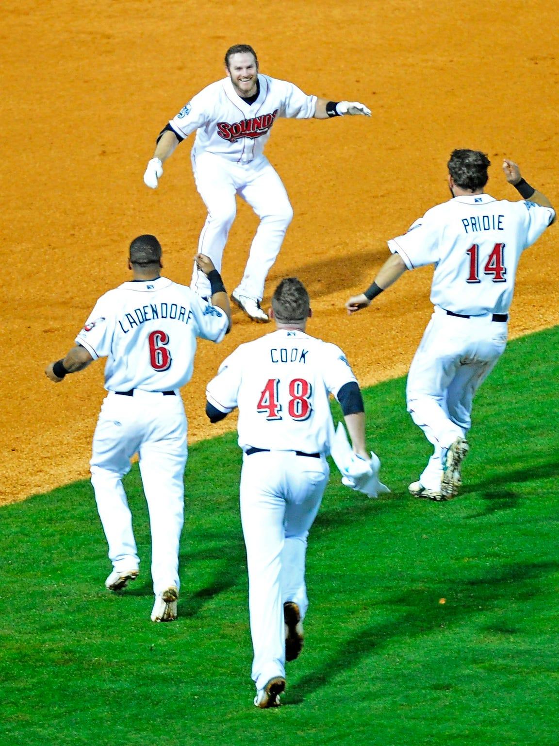 Max Muncy, top, celebrates with his teammates Jason