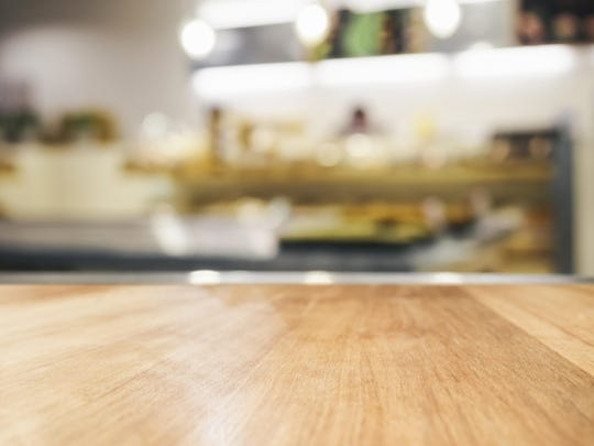 Looking for something a little more lively than white cabinets and granite countertops in your kitchen? Consider mixing several modern materials, finishes and colors.