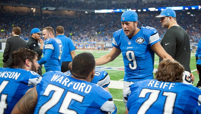 Sep 18, 2016; Detroit, MI, USA; Detroit Lions quarterback Matthew Stafford (9) talks to offensive lineman (from left) Travis Swanson, Larry Warford and Riley Reiff during the second quarter against the Tennessee Titans at Ford Field.