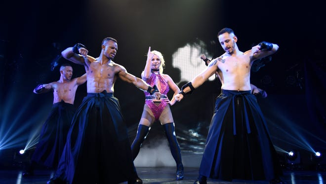 """Britney Spears performs on stage during her """"Piece of Me"""" summer tour ppener at The Theater at MGM National Harbor on July 12, 2018."""