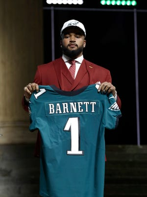 Tennessee's Derek Barnett poses after being selected by the Philadelphia Eagles during the first round of the 2017 NFL football draft, Thursday, April 27, 2017, in Philadelphia. (AP Photo/Matt Rourke)