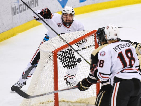 St. Cloud State's Jacob Benson react to a goal by teammate