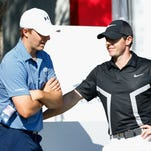 Jordan Spieth, left, chats with Rory McIlroy during the pro-am as a preview for the Abu Dhabi HSBC Championship at the Abu Dhabi Golf Club.