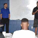 Clayton Moore (left) and Tyler Russell, quarterbacks in the 2008 Dandy Dozen, speak to the 2015 Dandy Dozen at Mississippi Veterans Memorial Stadium in Jackson on Tuesday, July 28, 2015.