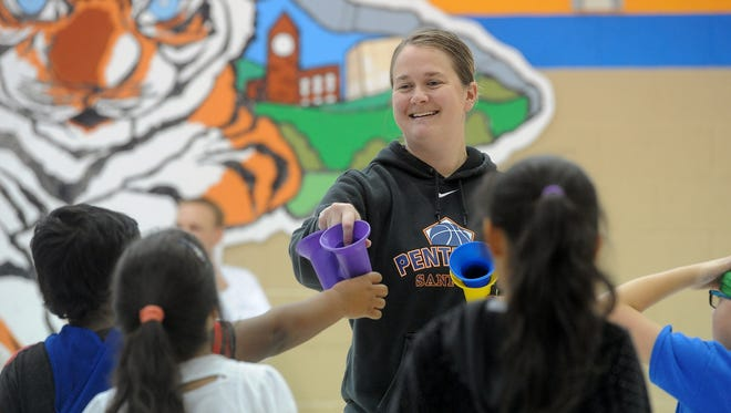 Gretchen Johnson, K-5th Grade Physical Education teacher at Cleveland Elementary School, talks with her students during class on Wednesday. Cleveland Elementary, which has an enrollment of 500, had 69 students open enroll and 189 leave the school to other elementary schools.