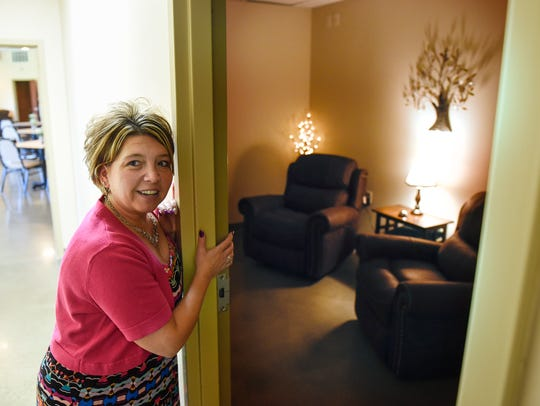 Margaret Kotula shows a quiet room at Arise Cares Senior