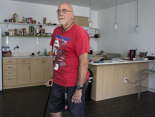 Harold Anweiler poses in his La Mesita apartment  in