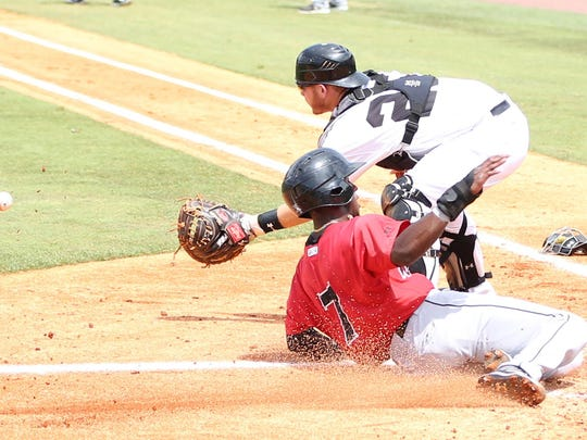 5 Baron's runner is safe at home ona late throw to Generals catcher Tyler Marle