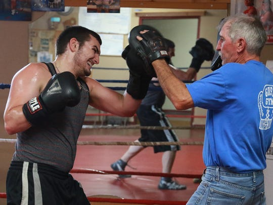 Noah Sconzert of Marshfield fires punches while practicing under the watchful eyes of trainer Don Jisko at the Gust Gym in the Oak Avenue Community Center, Thursday, August 27, 2015.