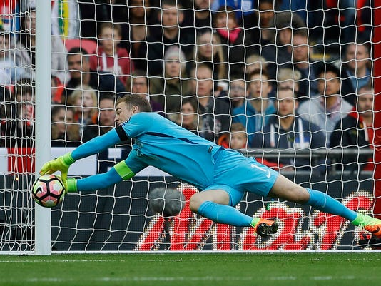 FILE - In this file photo dated Sunday, March 26, 2017, England's goalkeeper Joe Hart catches the ball during the World Cup Group F qualifying soccer match against Lithuania at the Wembley Stadium in London.  England's starting lineup for its opening match of the World Cup in Russia is thought to remain uncertain, making upcoming friendlies against Netherlands and Italy pivotal for England coach Gareth Southgate and for squad hopefuls like Hart who has been England's No. 1 for most of this decade but has lately struggled for confidence. (AP Photo/Frank Augstein, FILE)
