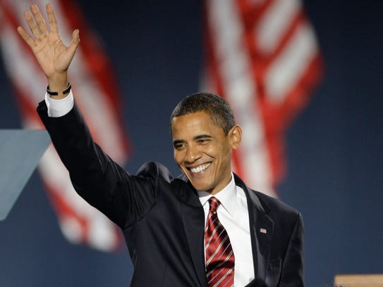 President-elect Barack Obama waves as he takes the