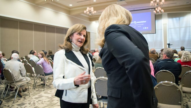 Paula Kollstedt, executive director of the Greater Cincinnati Alzheimer's Association and 2015 Enquirer Women of the Year honoree, talks with members of the Alzheimer's Association during a community education presentation Wednesday March 23, 2016. Kollstedt joined the Alzheimer's Association after her husband died of early-onset Alzheimer's. She now dedicates her time to increase funding and awareness for Alzheimer's.