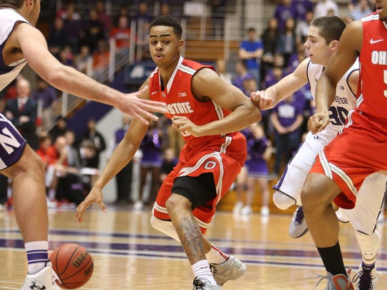 Ohio State Buckeyes guard D'Angelo Russell (0) dribbles