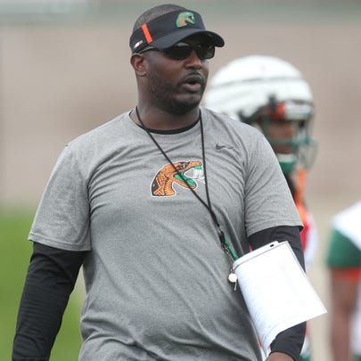 FAMU head coach Willie Simmons watches closely as the