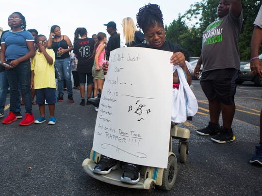 Supporters of Salome Thomas-EL brought signs and voices in praise of the head of Thomas Edison Charter School as Thomas-EL was reinstated to his position after being put on leave last week by the school's board.