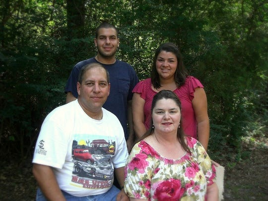 Clockwise from back left: Joey, Megan, Susie and Larry Cribbs pose for a family photo in 2011.