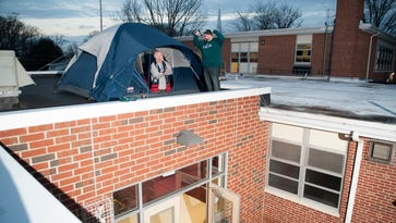 Principal, counselor settle rooftop Super Bowl wager