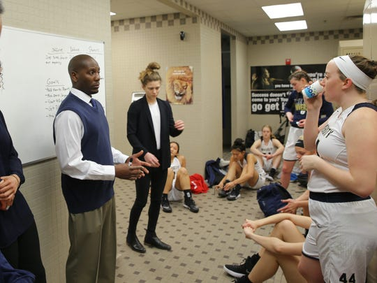 University coach Justin Blanding urges his team on before their gameTuesday.