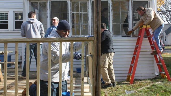 House of Heroes Connecticut volunteers work on a veteran's home in 2013.