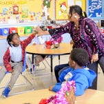 Teacher Rhonda Ansley high-fives student Kenneth O'Neal at EB Williams Stoner Hill Elementary Laboratory. EB Williams Stoner Hill Laboratory School is 1 of 3 central Shreveport elementary schools proposed to be closed because maintenance costs and population shifts in the city's core.