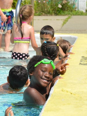 Kids in the pool during a Camp Splash session.