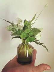 Jennifer May applies her eye for detail and beauty to flower arrangements.