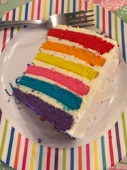 A piece of rainbow cake.