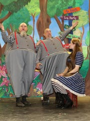 Alice (Carly Tizzano) is regaled by Tweedledee (Jim Wingren, left) and Tweedledum (Scott Snively).