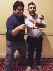 Spanspek Music and Arts Festival founders Cristobal Carrillo and Israel Flores accept a Golden Apple Service Award from Cutler-Orosi Joint Unified School District and the Association of California School Administrators.