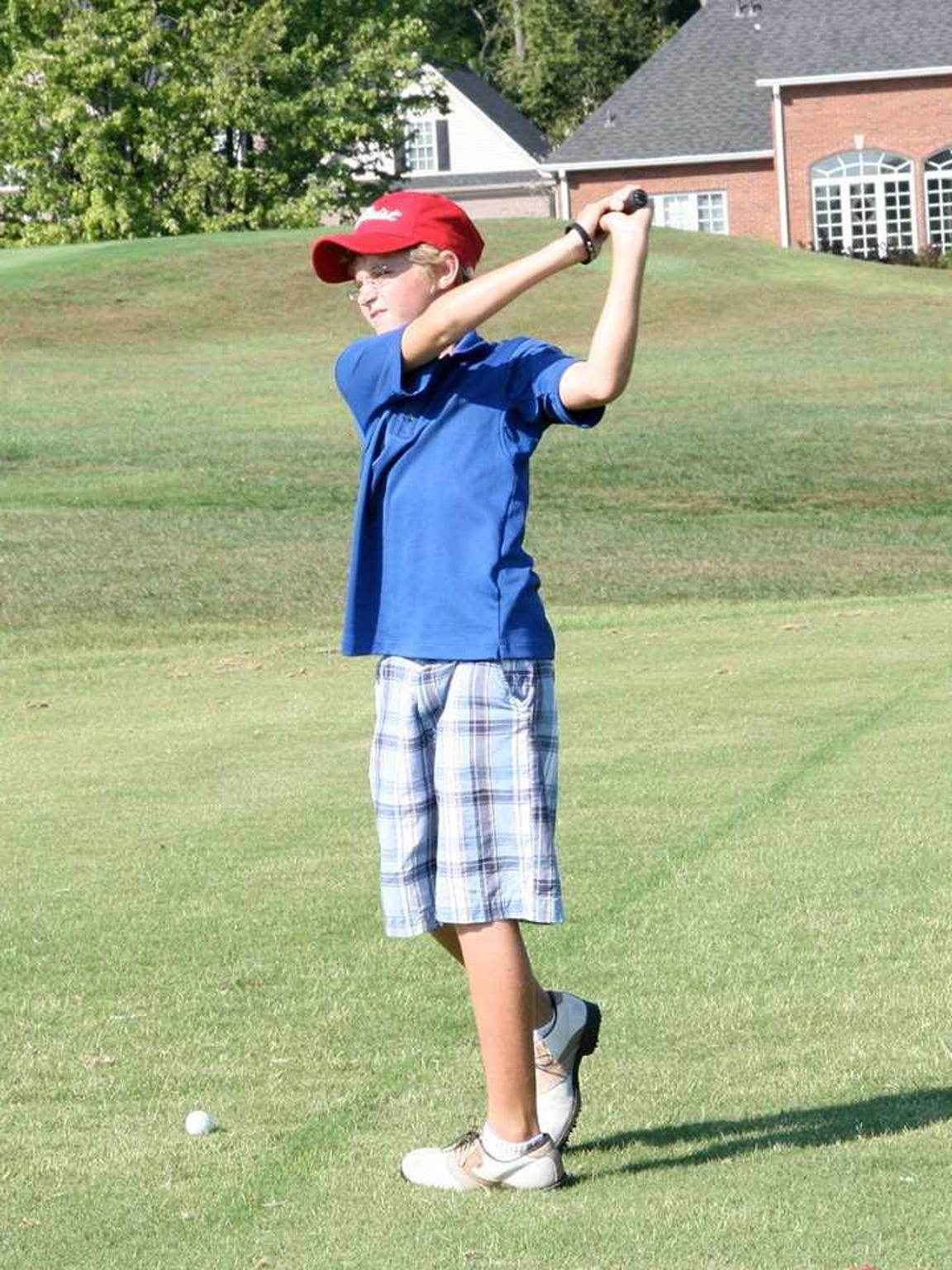Dylan Meyer takes a practice swing during his younger