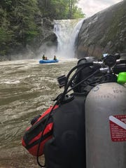 Dive teams have been searching the pool below Elk River Falls in Avery County in depths of up to 100 feet for a man who drowned there Sunday.