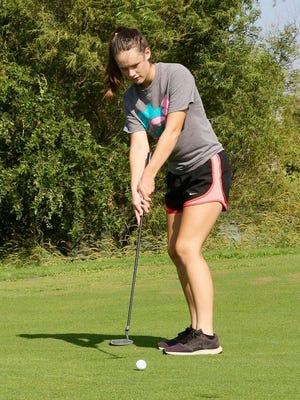 Pretty Prairie's Raegan McLeland works on her putting during practice before the season.