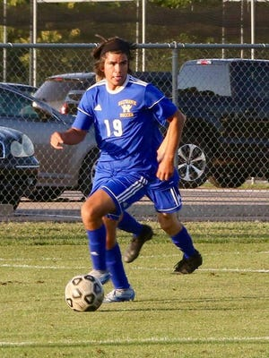 Hutchinson's Bobby Garland dribbles the ball during Thursday's game against Andover Central. The Salthawks lost 2-1.