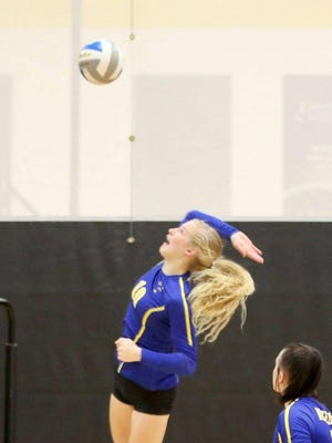 Nickerson's Ava Jones goes for the kill during Tuesday's triangular with Haven and Halstead.