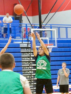 Central Christian's Caleb Yoder drills a 3-pointer against Canton-Galva during Thursday's summer-league game. Yoder is a returning starter from last year's CCS squad which reached the sub-state championship.