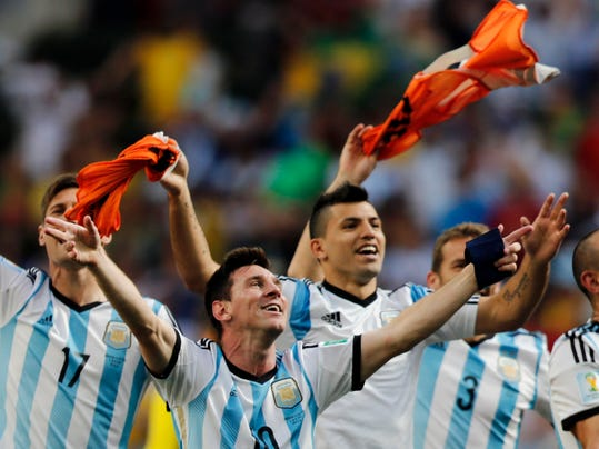 Argentina's Lionel Messi and teammates celebrate at the end of the World Cup quarterfinal soccer match between Argentina and Belgium at the Estadio Nacional in Brasilia, Brazil, Saturday, July 5, 2014. Argentina won 1-0. (AP Photo/Thanassis Stavrakis)