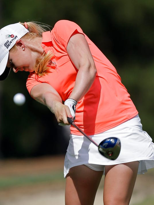 Stephanie Meadow, of Northern Ireland, hits her tee shot on the 18th hole during the third round of the U.S. Women's Open golf tournament in Pinehurst, N.C., Saturday, June 21, 2014. (AP Photo/Bob Leverone)