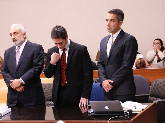 Alberto Antonio Mendiola makes the sign of the cross Tuesday after he was acquitted of murder but convicted of manslaughter in the slaying of Anthony Bowler, 30, on March 22, 2014.