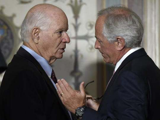 Senate Foreign Relations Committee Chairman Sen. Bob Corker, R-Tenn., right, talks with the committee's ranking member, Sen. Ben Cardin, D-Md., on Capitol Hill on July 16, 2015, after a meeting with Vice President Joe Biden and other committee members to discuss the nuclear agreement with Iran.