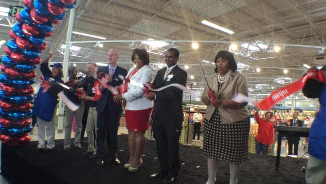 Officials including Detroit City Council President Brenda Jones, right, cut a ribbon to mark the opening this morning of a Meijer store at Grand River and McNichols in Detroit, the company's second Detroit location.