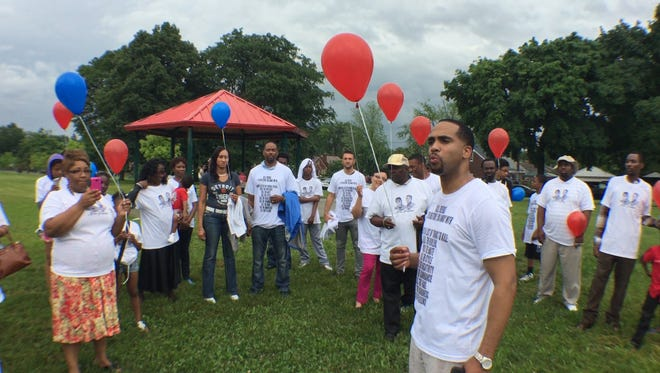Minister Earthel Parker tells relatives and friends of John Jones and Christopher Jones-Olbrys, two Detroit brothers killed seven years apart whose murders remain unsolved, to use the release of balloons as a way to release the pain their deaths caused.