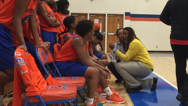 Hunters Lane coach Schronda Moore talks to her team during Thursday's 12-AAA tourney contest.