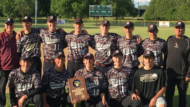 The N.E.W. Lutheran baseball team poses with its sectional championship plaque after beating Burlington Catholic Central 7-6 on June 7 in a WIAA Division 4 sectional final game at Johnson Creek. Pictured in front row (left to right): Lucas Bukowski, Tanner Natzke, Brock Reisler, Bryce Henninger and Brandon Macklem. Pictured in back row: Head coach Mike Stock, Samuel Meerstein, Jed McClellan, Erik Voskamp, Mitchell Lynch, Brandon DeMeuse, Joshua Waldschmidt and assistant coach Stu Stock.