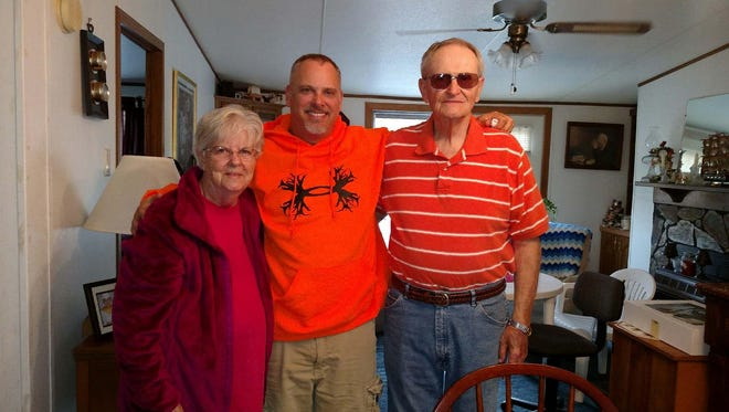 Ken Gaskins (right) joins his wife, Jean, and son, Chris.
