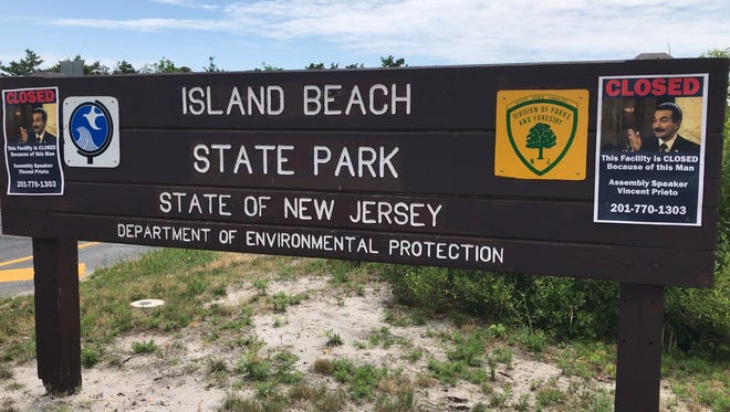 The entrance sign for Island Beach State Park, as it appeared Saturday, following the state government shutdown.